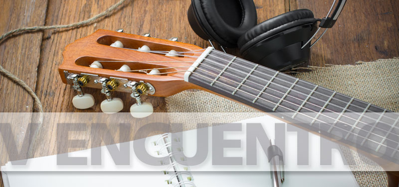 V Encuentro, guitar with headphones