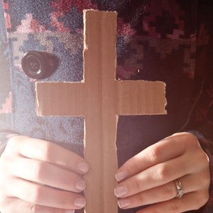 Person holding cross