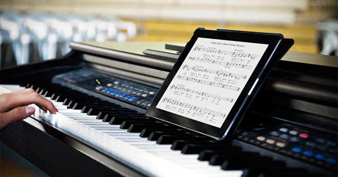 A keyboard using an Ipad for sheet music