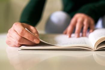 Person looking through a book